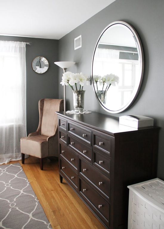 round mirror over long dresser (both Ethan Allen) paint: Benjamin Moore's Amherst Grey, small mirror: Pottery Barn, Jill Rosenwald Fallon rug. Master bedroom or Office wall color.