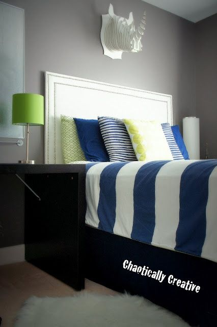 I love the clean lines and color combo... Benjamin Moore Granite Colors--grey walls, dark blue and pops of green