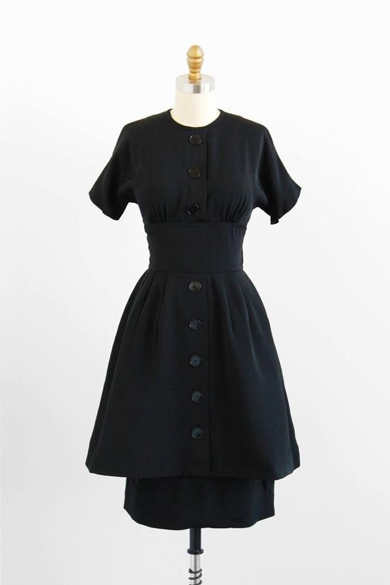 A timelessly elegant 1950s black double skirted dress. #vintage #fashion #1950s #dress