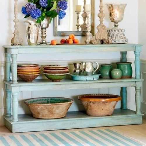 Pale blue painted furniture with an aged finish is inspired by coveted blue seag