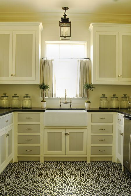 Neutral kitchen with two-tone painted cabinets.  Amazing pebble floor.