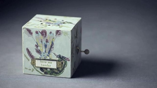 Something's Hiding in Here by BHLDN. A handmade music box plays a little tune that says a lot.