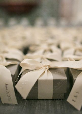 Gray & White Favor Boxes  // Photo: Samuel Lippke Studios and Allan Zepeda // Wedding Planning: Details Details // TheKnot.com