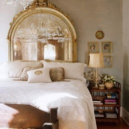 gilded mirror as headboard + soft and feminine bedroom