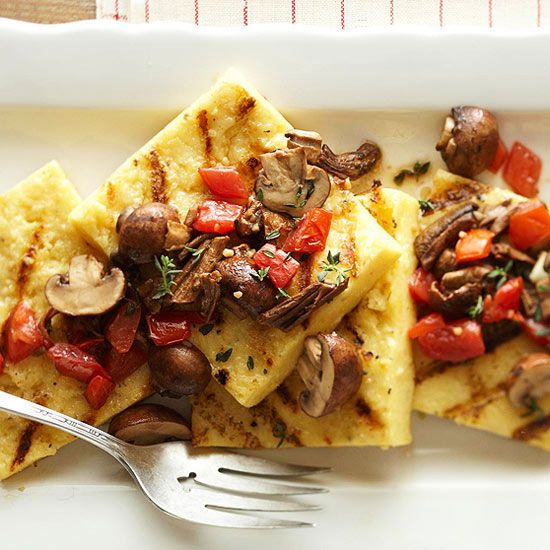 Grilled polenta is topped with a garlicky, wine-infused blend of mushrooms and roma tomatoes. More grilled appetizers: www.bhg.com/...