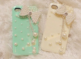 iphone 4 case, cute iPhone 4 case bow, pearl iPhone 4 case, bow iphone 4s case, bling iphone 4 case, iphone 4 cases iphone 5 cover case. $9.98, via Etsy.