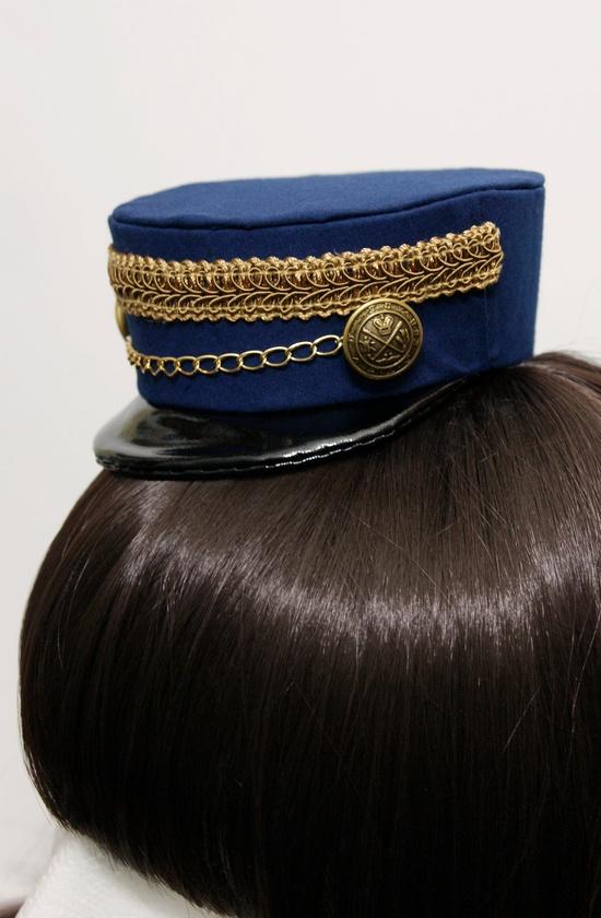 Dark Blue and Gold Gothic and Lolita Mini Train Conductor Hat. $45.00, via Etsy.