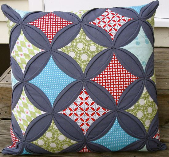 Cathedral window pillow by Hazelnutgirl, via Flickr