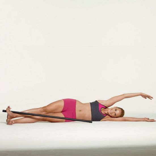 Grab a body bar and lay on your side for a serious leg sculpting move.