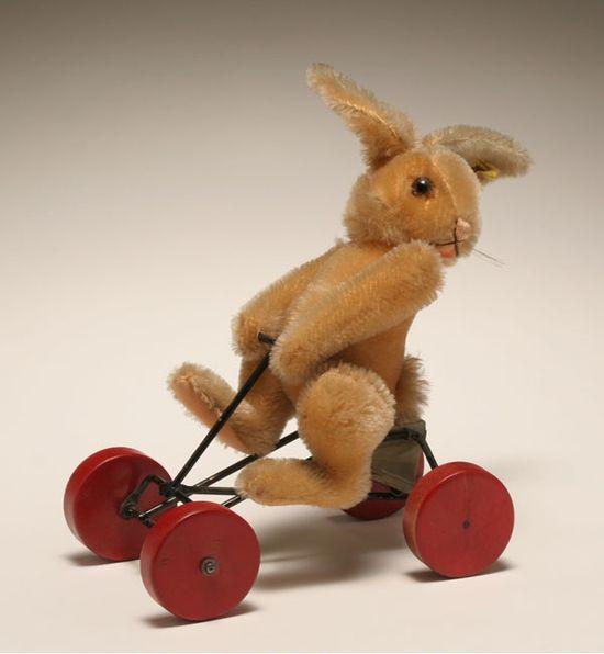 Steiff rabbit on go-kart.