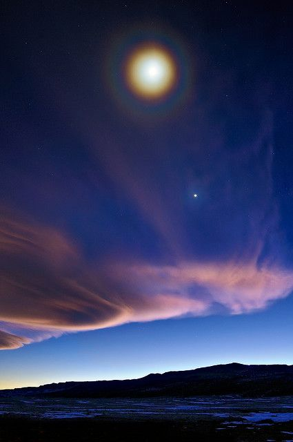 Full Moon Halo Over a First Quarter Moon