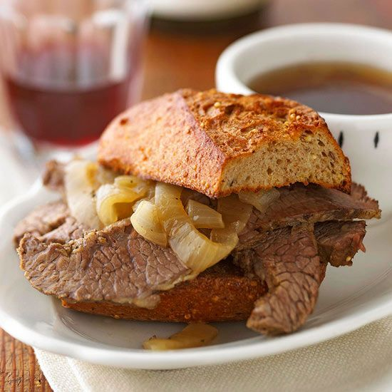 Juicy, slow-cooked beef brisket makes a delicious French Dip sandwich. More simple slow-cooker recipes: www.bhg.com/...