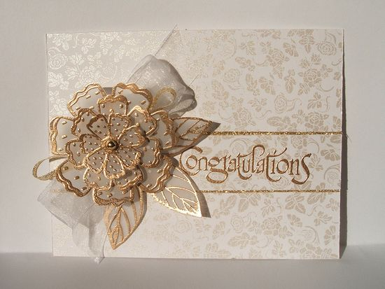 Elegant card with stunning gold embossed and layered vellum flower...gorgeous!!!...base paper lovely with small pearlized rose print...luv it!!!