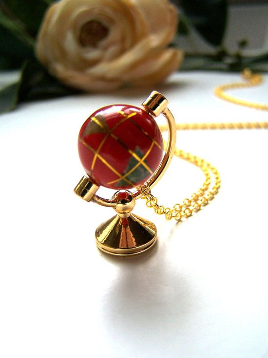the world on a string necklace in red. $25.00