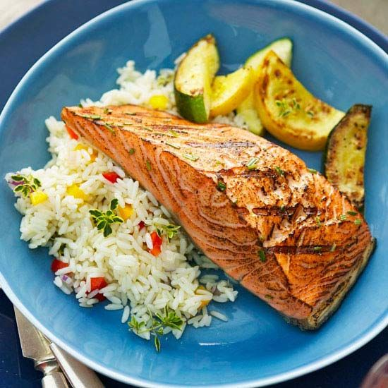 This Sweet & Smoky Grilled Salmon is topped with a delicious brown sugar, thyme, and lemon juice glaze. Recipe: www.bhg.com/...