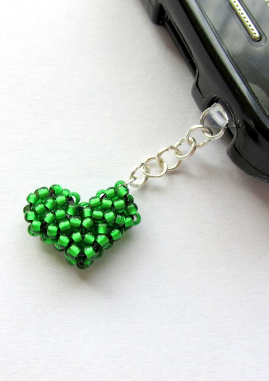 This green phone charm is a cute little hand beaded heart connected to a clear anti dust plug by silver plated chain.   Made with high quality Japanese seed beads and high quality beading thread this will make a fantastic stocking stuffer for any of the green lovers in your life!   $5.50