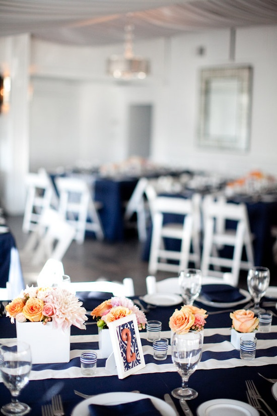 Ribbons on the votives! Striped table runner and navy table cloths