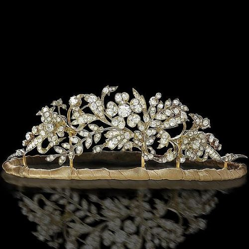 Circa 1890 floral diamond tiara was exhibited in the diamond tiara exhibit by Wartski. This piece was recently sold at auction. The flowers detach to make earrings, brooches and/or a pendant.