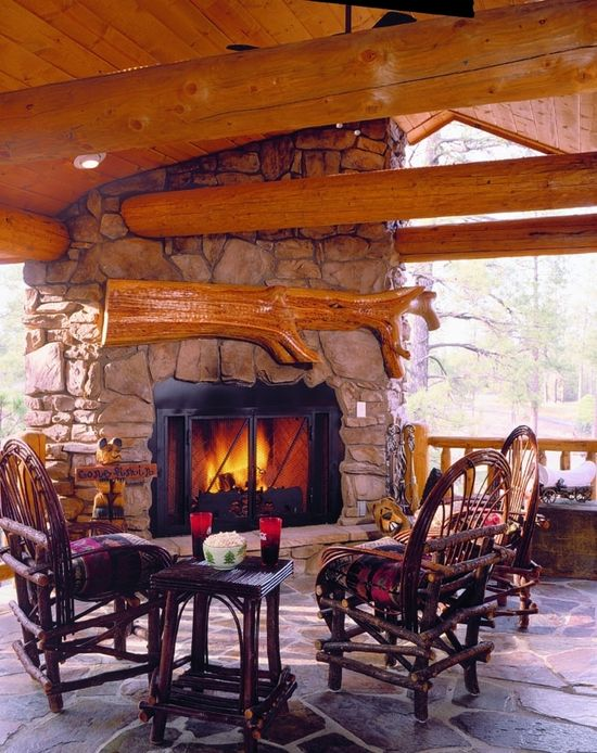 """Beautiful outdoor fireplace.  Love the beams and """"matching"""" mantel."""