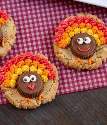 Peanut Butter Cup Turkey Cookies have a triple-shot of peanut butter - in the cookie, the cup and the frosting! #Thanksgiving #cookies @Kathryn Whiteside Whiteside Baker@350