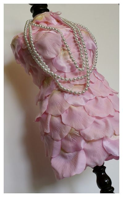 DIY jewelry holder directions: Pretty necklace mannequin covered with rose petals!
