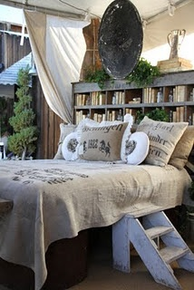 bookcase headboard – love this look! How I wish my husband would go for it.
