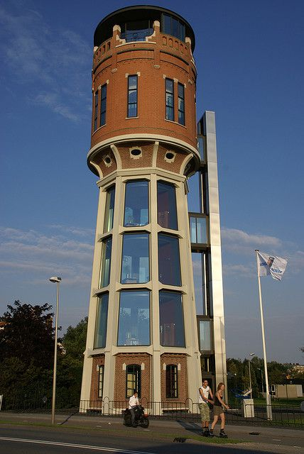 This art nouveau water tower was transformed into a modern office. Holland
