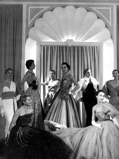 A group of models sporting immensely beautiful Pierre Balmain evening fashions, 1952. #vintage #fashion #1950s