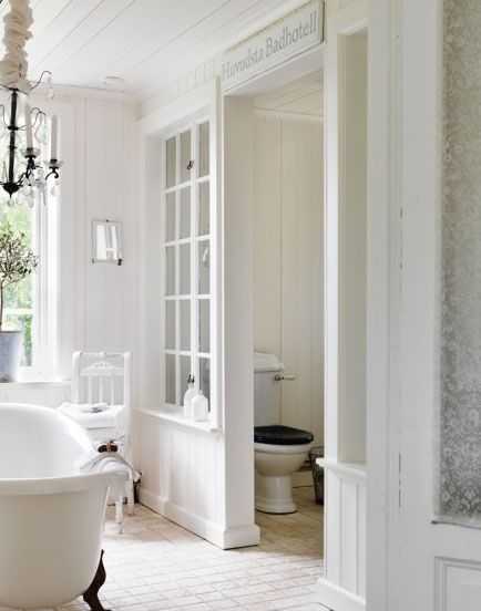 a beautiful way to divide bathroom space