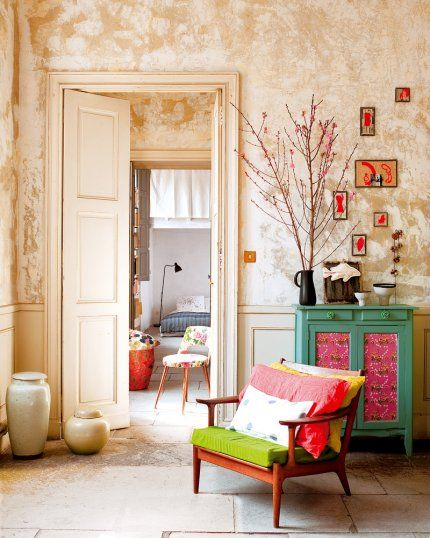 Myriam Balay Devidal's apartment in Nîmes (Southern France) (click for more images). Wall colour was achieved by pulling down the original wallpaper and leaving the bare plaster walls exposed.