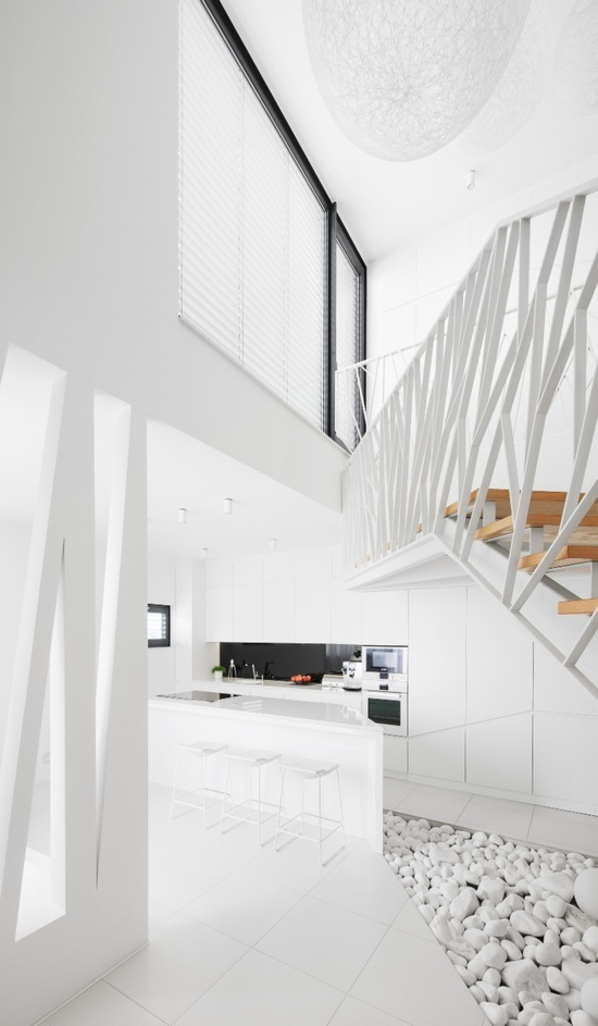 white interior with angular staircase and wall details