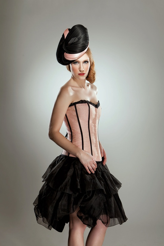 This hat is a hand-sculpted stunner, and the perfect accessory for an extra-bold look like this. $300.00