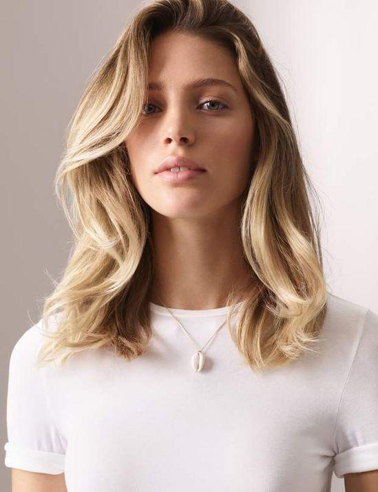 La coupe mi-longue soupleUne coupe idéale pour mettre en valeur les cheveux épais.