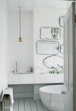Mirrors and marble.... A perfect bathroom combination