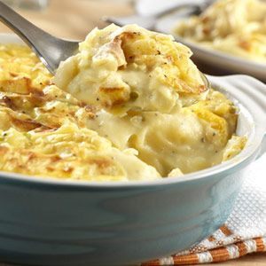 Cheddar Potato Casserole Recipe ~ Savory mashed potatoes are laced with a cheddar cheese sauce, sour cream and green onion. Baked to a golden turn, this dish is a real crowd pleaser.