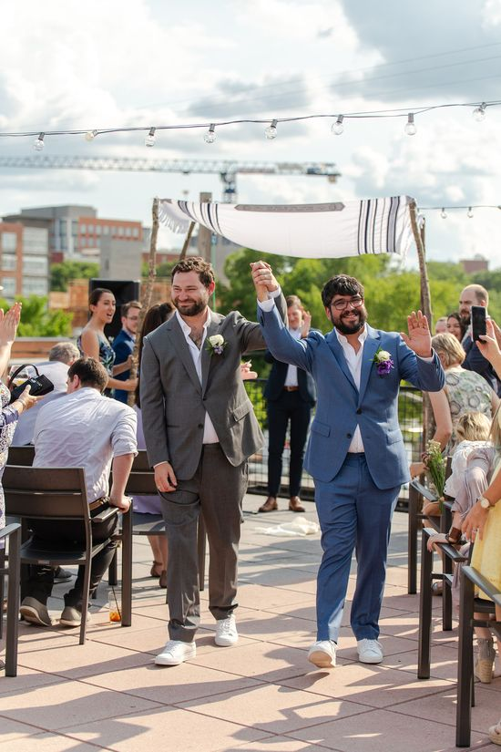 Love to see these happy grooms celebrating their marriage in Durham, NC! The charm of the city and this handsome couple made for a perfect day. These grooms tied the knot at The Pitt Durham and MKM Photography was there every step of the way.