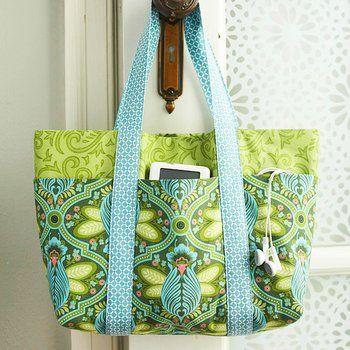 green and blue bag on doorknob