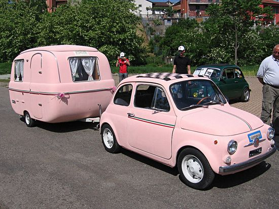 Vintage Fiat with matching camper in pink.