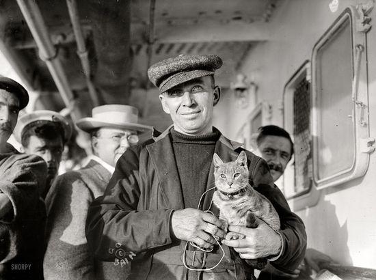 Melvin Vaniman and his cat aboard the steamship Trent off Bermuda, Oct. 1910