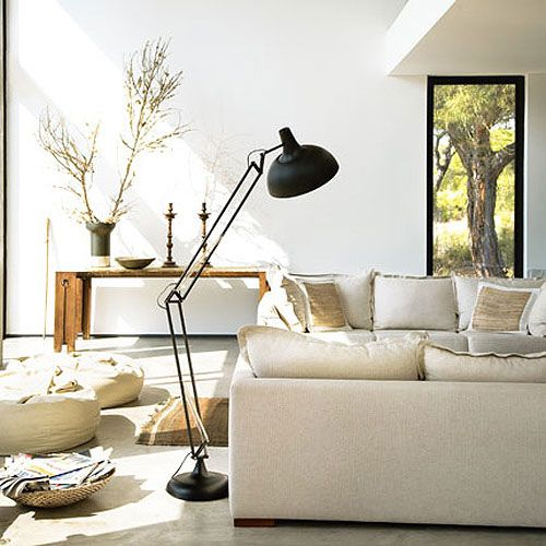 Love the neutrals of the rustic pillows, poufs and handwoven rugs
