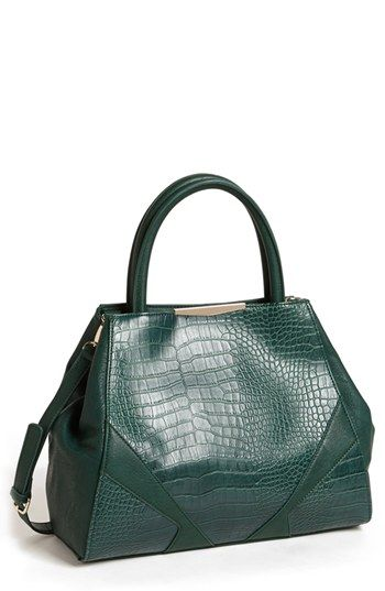 The style is ladylike, but the size (and storage within) makes this bag all business.