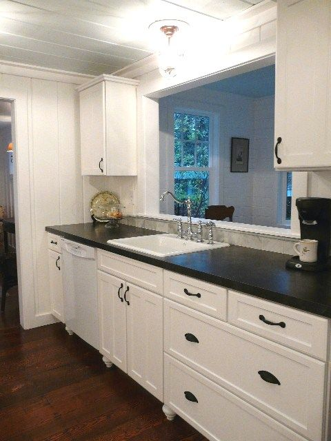 I love the Black counters with white cabinets! I want my kitchen like this!