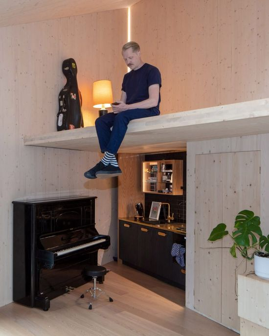 Above, the first floor contains the music studio. Its angular form was developed to help enhance the acoustics of the space and make it suitable for recording music.