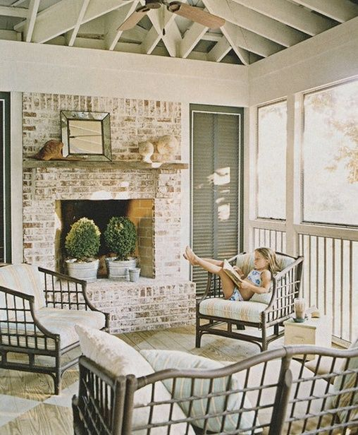 Screened in porch, with a fireplace