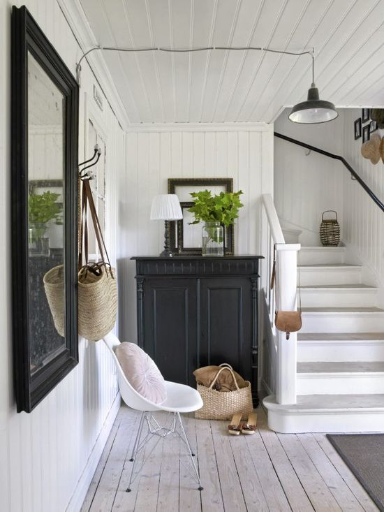 foyer, black painted cabinet, white and tan, foliage in jar
