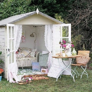 Shabby chic summer house with which chair and nice garden table and chair