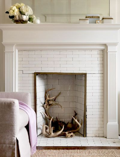 antler filled fireplace.