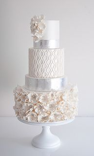 Quatrefoil Wedding Cake - I like that it is a mixture of your current cake (petals) and adding in the pattern