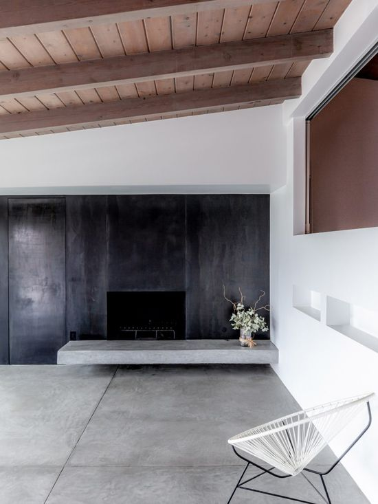 The interior decor is minimal including polished concrete flooring and several structural steel posts.