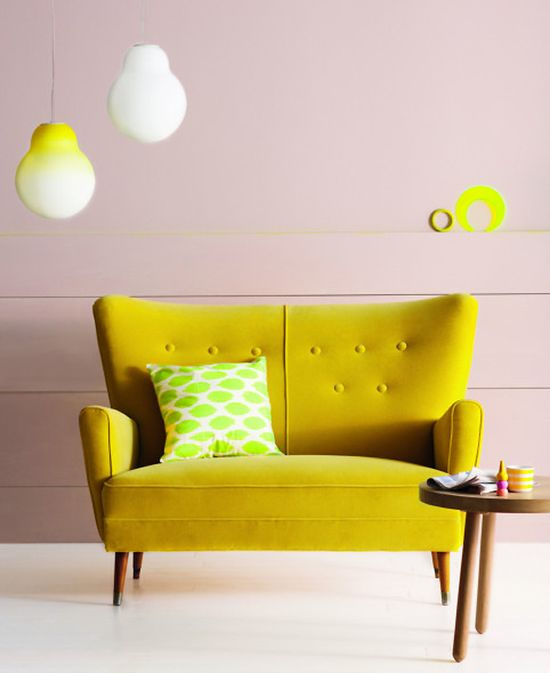 A hit of neon and a mid-century style sofa